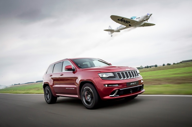 VIDEO: Jeep Pits Grand Cherokee SRT Against Aerobatic Plane in Air/Track Dogfight