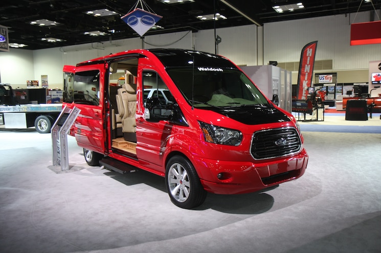 Ford Transit With Wood Flooring And Tvs In The Interior