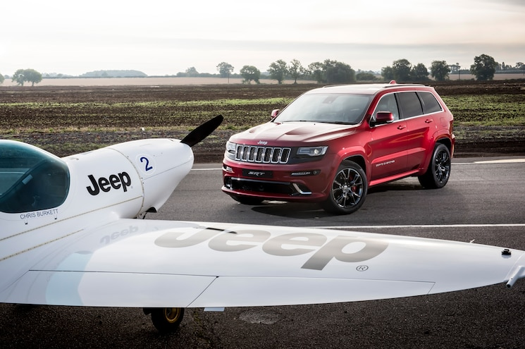 2017 Jeep Grand Cherokee Vs Plane In Foreground