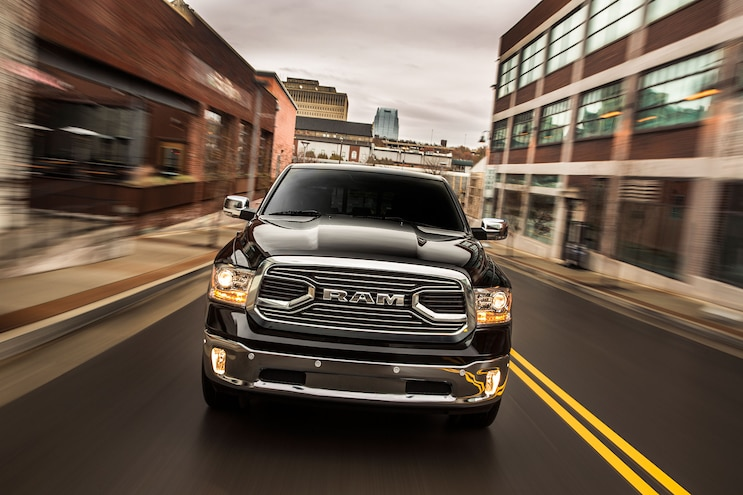 023 2016 Ram 1500 EcoDiesel Limited Front View Driving On Road High Speed