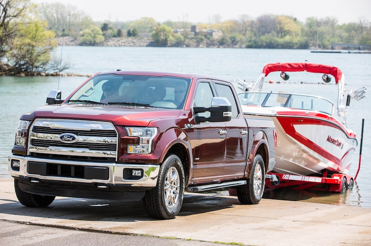 Red Ford Pickup Truck Towing Boat