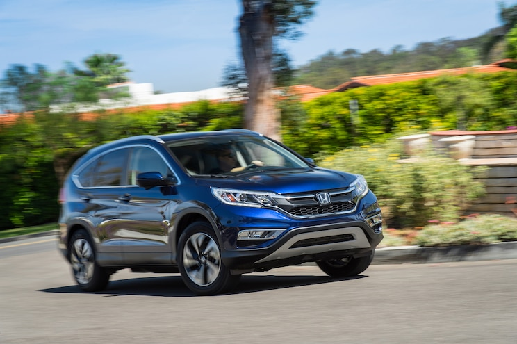 2015 Honda CR V Touring AWD Front Three Quarter In Motion 021