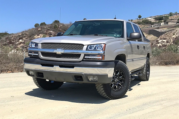 Skyjacker Leveling Kit, Atturo Tires, Black Rhino Wheels, N-Fab Steps on a 2004 Avalanche
