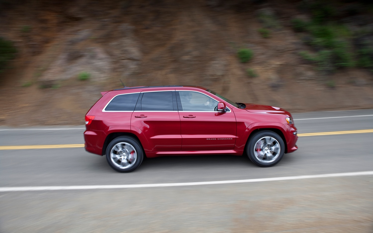 2012 Jeep Grand Cherokee SRT8 Side In Motion