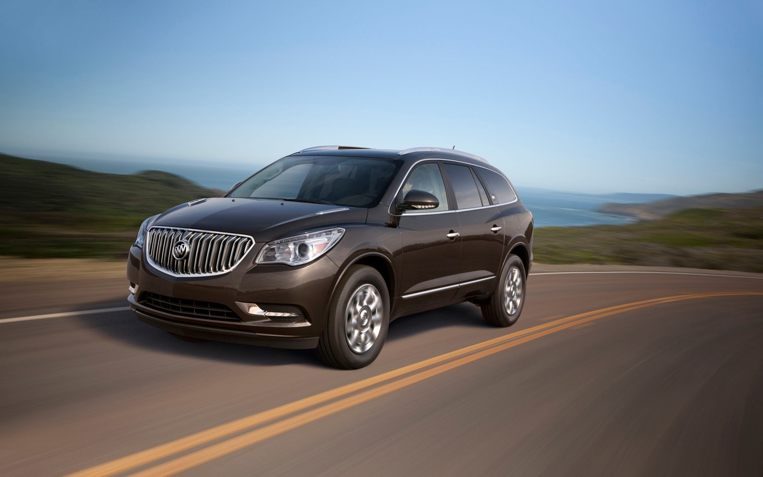 2013 Buick Enclave Front Three Quarters In Motion 3
