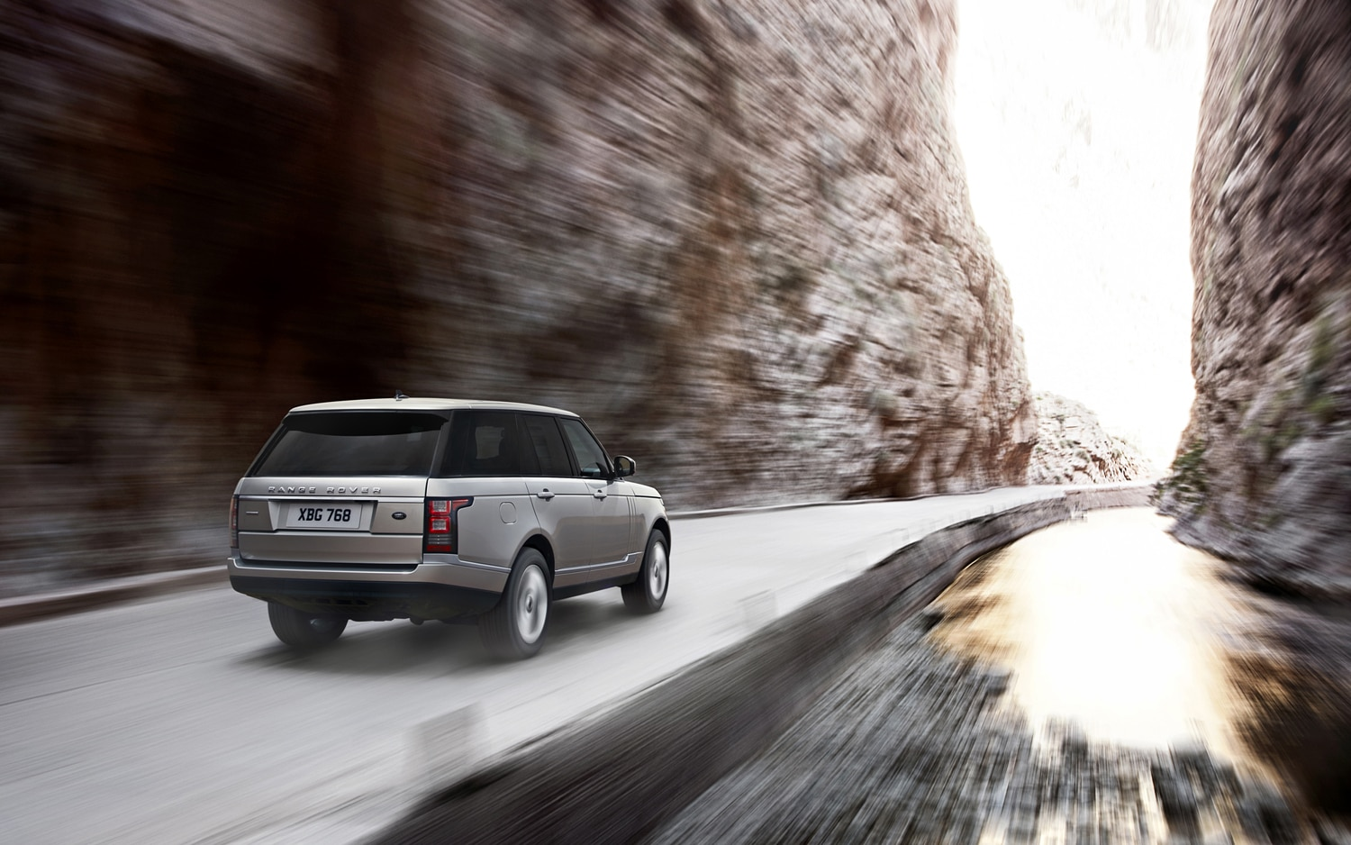 2013 Land Rover Range Rover Rear Three Quarters In Motion 3