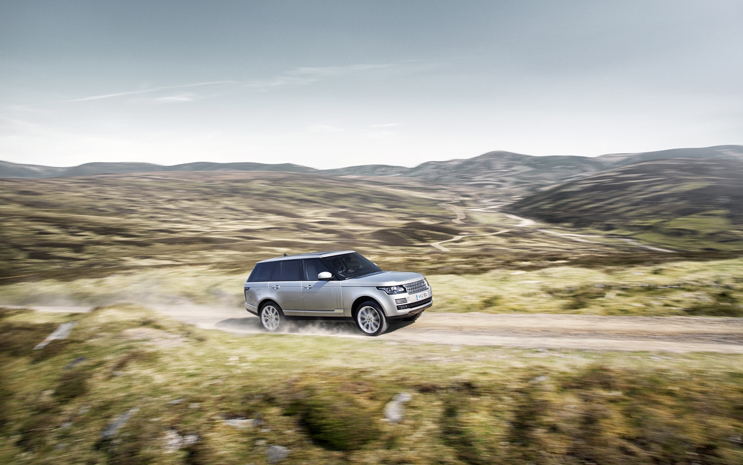 2013 Land Rover Range Rover Side In Motion 8
