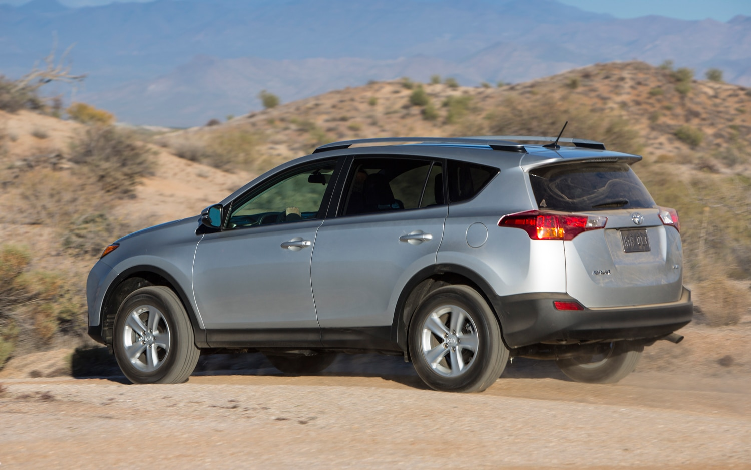 2013 Toyota RAV4 XLE Rear View In Motion 01