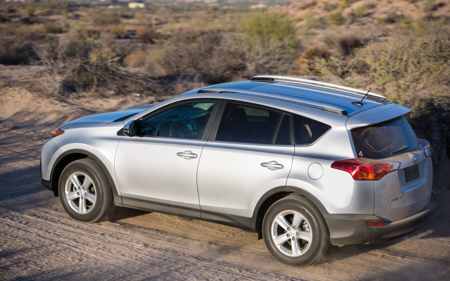 2013 Toyota RAV4 XLE Rear View In Motion