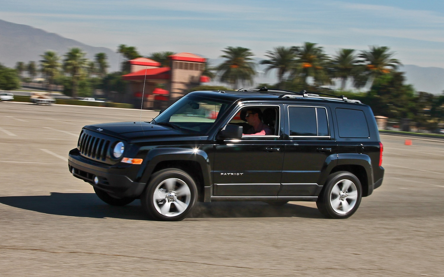 2013 Jeep Patriot Latitude 4X4 Front View In Motion 02