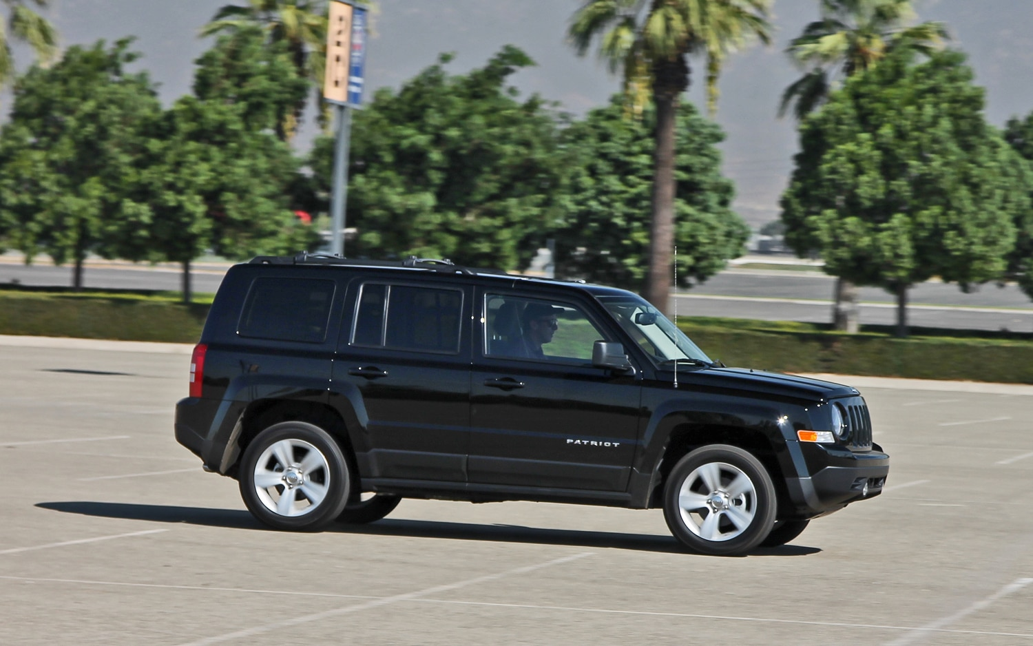 2013 Jeep Patriot Latitude 4X4 Side View In Motion 02