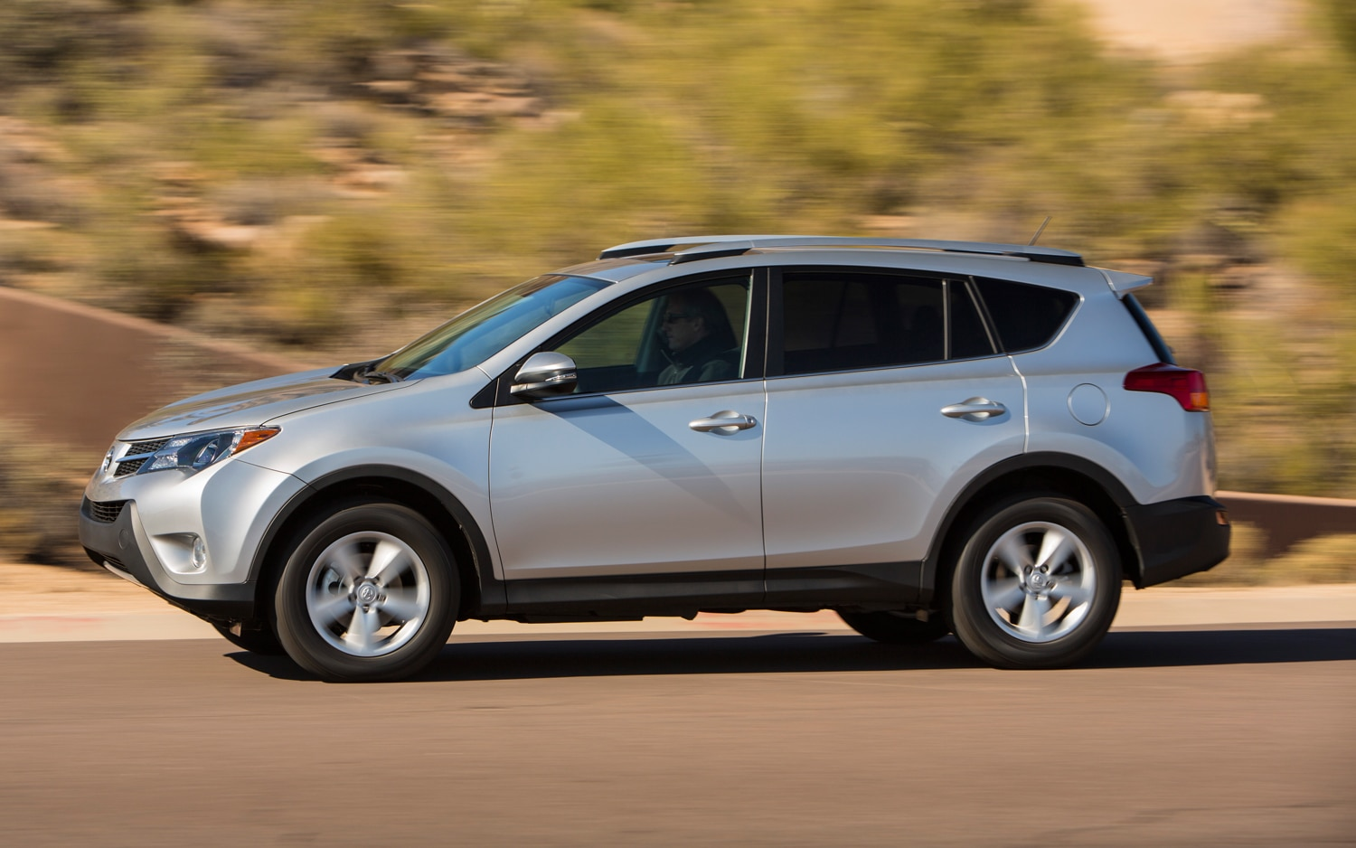 2013 Toyota RAV4 XLE Side View 05