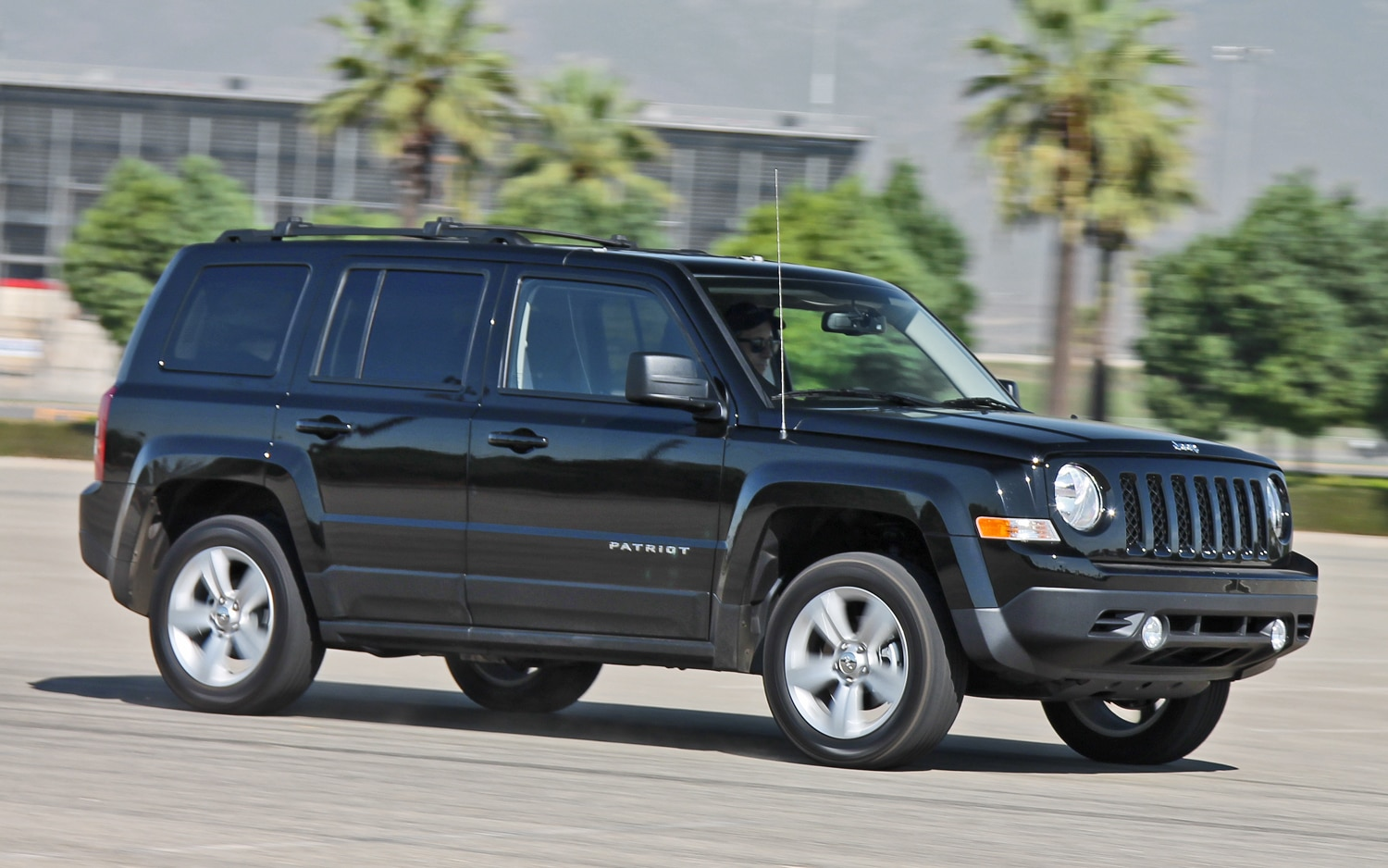 2013 Jeep Patriot Latitude 4X4 Front View In Motion 03