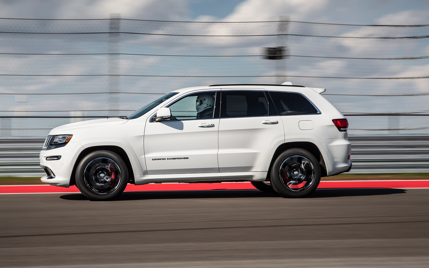 2014 Jeep Grand Cherokee SRT Side View In Motion 5