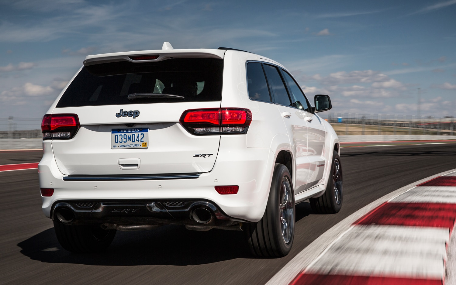 2014 Jeep Grand Cherokee SRT Front View In Motion 1