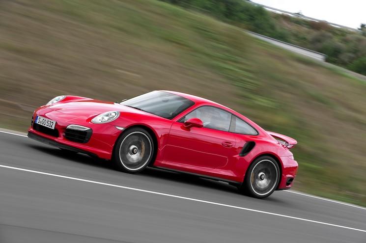 2014 Porsche 911 Turbo Side In Motion 02