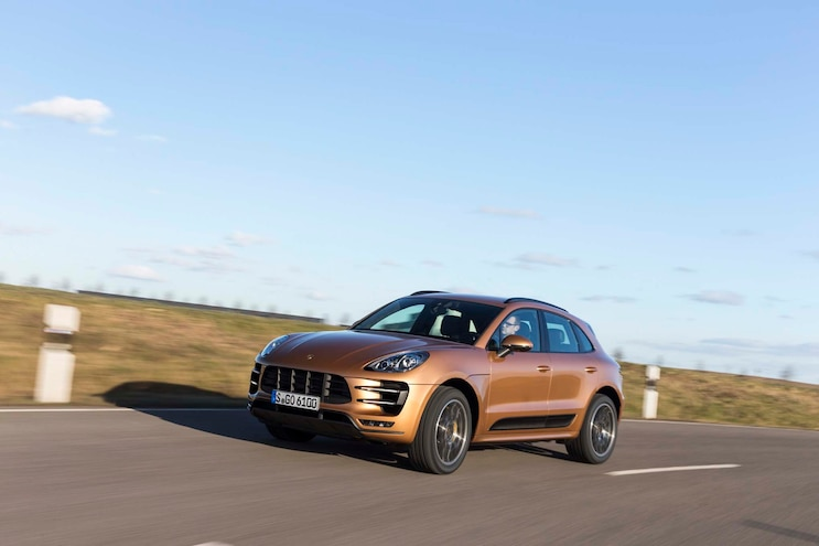 2015 Porsche Macan Turbo Front Three Quarters In Motion 02