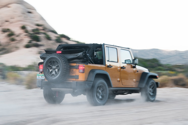 2014 Jeep Wrangler Unlimited Willys Wheeler Rear View In Motion