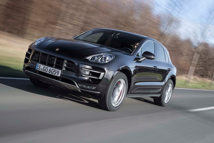 2015 Porsche Macan Turbo Front Three Quarters In Motion 04