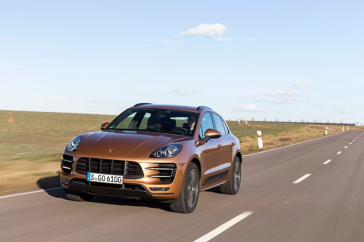 2015 Porsche Macan Turbo Front Three Quarters In Motion 03