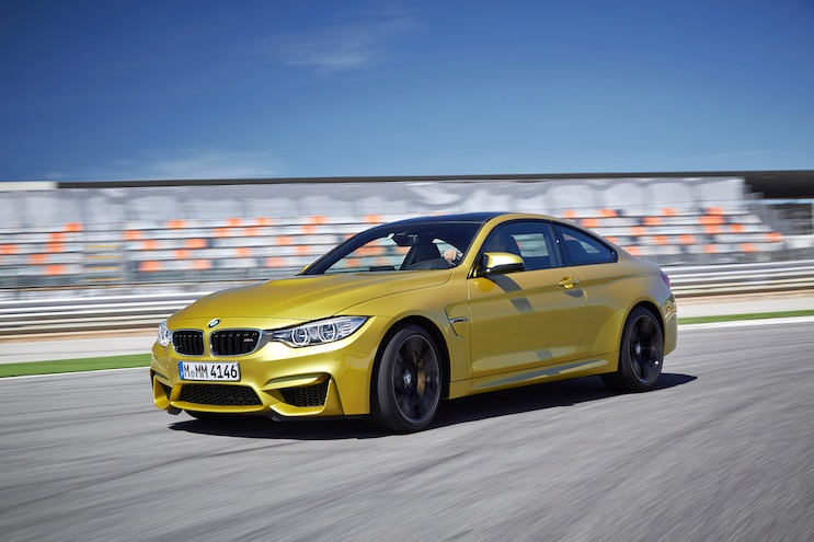 2015 BMW M4 Coupe Front Three Quarters In Motion 09