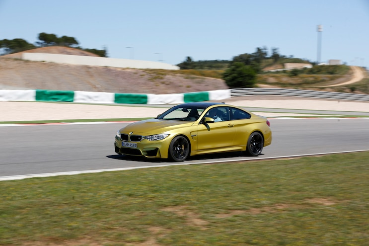 2015 BMW M4 Racetrack Front Three Quarters In Motion 02