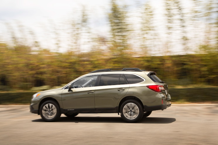 2015 Subaru Outback 25 Limited Rear Three Quarter In Motion