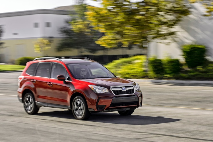 2014 Subaru Forester 20XT Front Three Quarter In Motion 02