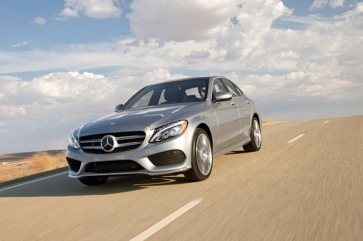 2015 Mercedes Benz C300 4Matic Front Three Quarter In Motion 02