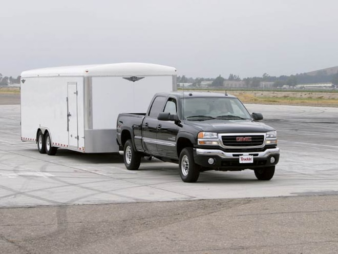 2004 GMC Sierra 2500 HD Crew Cab Front Passengers Side View With Trailer