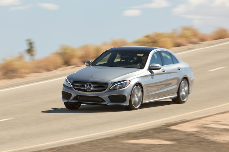 2015 Mercedes Benz C300 4Matic Front Three Quarter In Motion 03