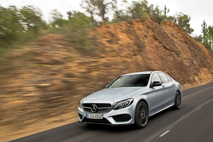2016 Mercedes Benz C450 AMG 4Matic Front Three Quarter In Motion 04