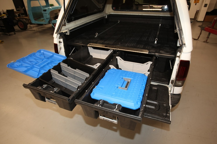 Installing a truck bed storage system, spray in bedliner & window tint on to our 2004 Ford F250