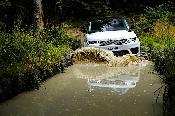 029 2020 Diesel Light Truck SUV Buyers Guide Range Rover Sport Exterior Action Mudding