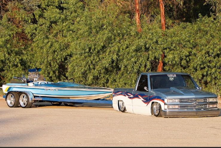 Slammed Chevy Towing Boat
